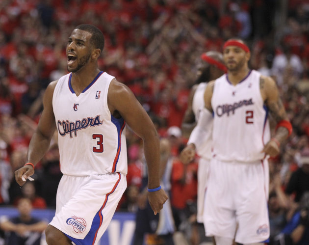Los Angeles Clippers' Chris Paul celebrates a basket during overtime in a NBA first-round playoff basketball game against the Memphis Grizzlies in Los Angeles, Monday, May 7, 2012. The Clippers won 10
