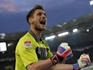 Stuttgart's goalkeeper Sven Ulreich reacts after his team scored the winning goal during the German first division Bundesliga football match between VfB Stuttgart and Eintracht Frankfurt in Stuttgart, southwestern Germany. Stuttgart won the match 2-1