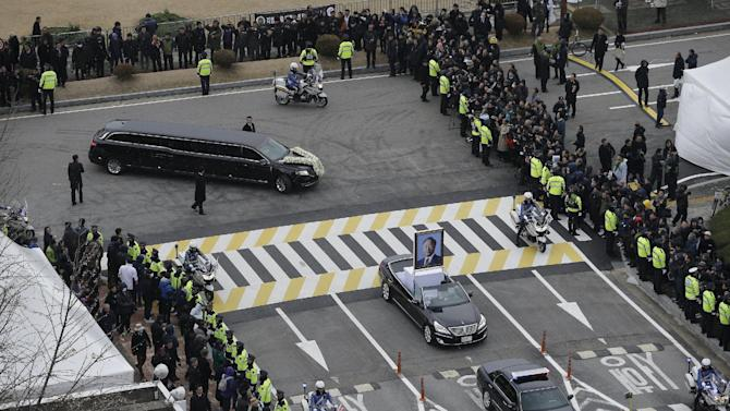 A vehicle bearing a portrait of the late former South Korean President Kim Young-sam leads a hearse after his state funeral, at the National Assembly in Seoul