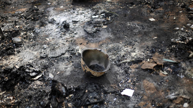 In this image taken during an official visit organized by the Malian army to the town of Konna, some 680 kilometers (430 miles) north of Mali's capital Bamako, Saturday, Jan. 26, 2013, a charred helmet lays on the ground of a destroyed base used by islamist rebels.  One wing of Mali's Ansar Dine rebel group has split off to create its own movement, saying that they want to negotiate a solution to the crisis in Mali, in a declaration that indicates at least some of the members of the al-Qaida linked group are searching for a way out of the extremist movement in the wake of French air strikes. (AP Photo/Jerome Delay)