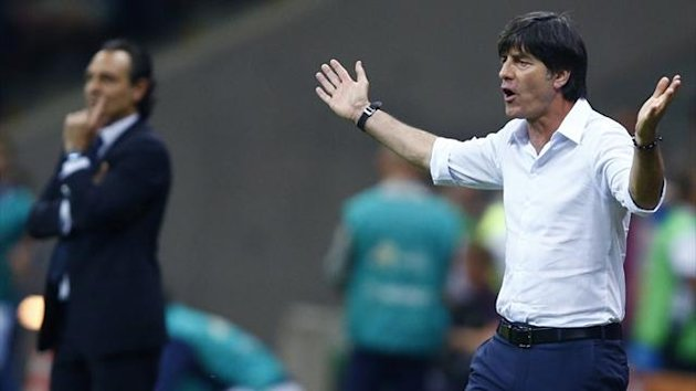 Germany coach Joachim Loew reacts next to Italy coach Cesare Prandelli during their Euro 2012 semi-final match (Reuters)