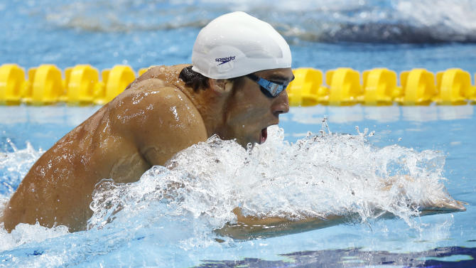 USA's Michael Phelps competes in a heat of the men's 400-meter individual medley at the Aquatics Centre in the Olympic Park during the 2012 Summer Olympics in London, Saturday, July 28, 2012. (AP Photo/Daniel Ochoa De Olza)