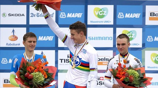 Gold medalist Oskar Svendsen (C) of Norway, silver medalist Matej Mohoric (L) of Slovenia and bronze medalist Maximilian Schachmann (R) of Germany pose on the podium of the Men's Junior Time Trial of the Cycling World Championships in Valkenburg, Netherla