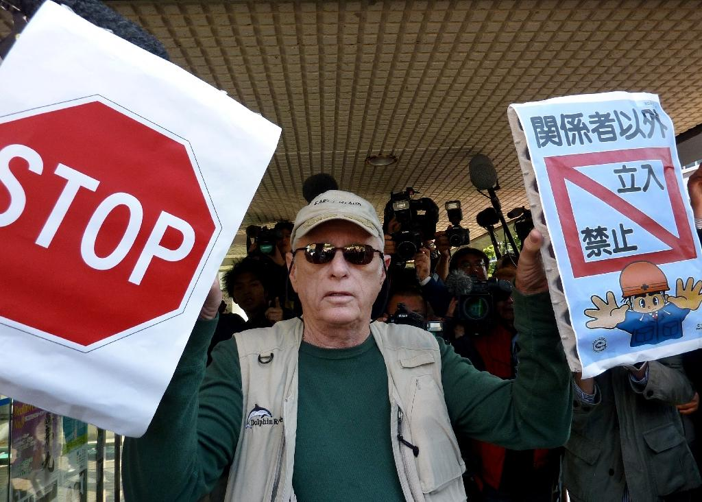 Japanese town's controversial dolphin hunt begins