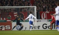 VfB Stuttgart's Vedad Ibisevic (2ndR) scores past Vfl Bochum's goalkeeper Andreas Luthe (L) and Vfl Bochum's Marcel Maltritz (2nd L) during their German soccer cup (DFB Pokal) quarter final match in Stuttgart February 27, 2013. REUTERS/Lisi Niesner