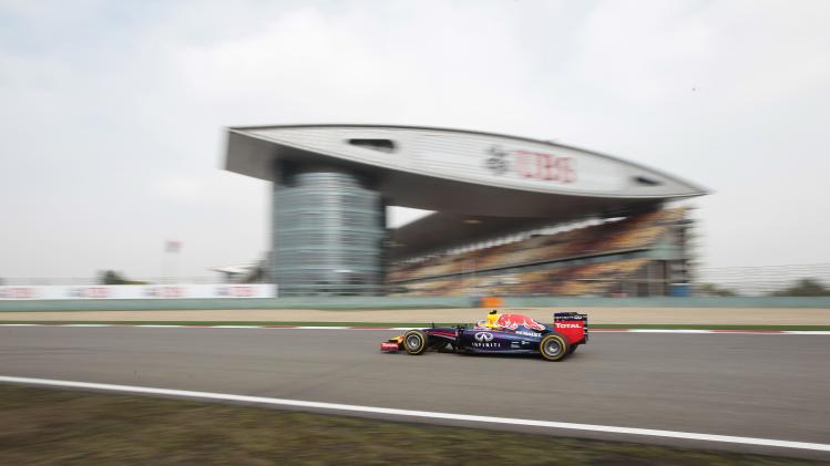 Red Bull Racing Formula One driver Ricciardo of Australia drives during the second practice session of the Chinese F1 Grand Prix at the Shanghai International circuit