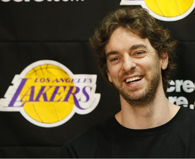 In this April 30, 2013 file photo, Los Angeles Lakers power forward Pau Gasol smiles while talking to reporters during an NBA basketball news conference in El Segundo, Calif.  Gasol spent the past few