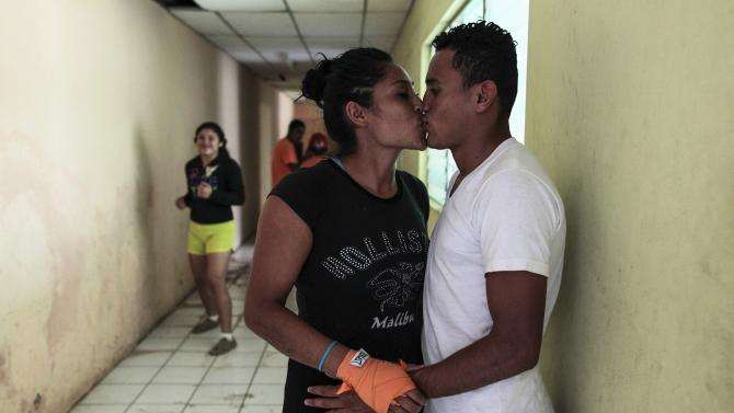Aguirre kisses her boyfriend after her training session at the National Institute of Sport in Managua