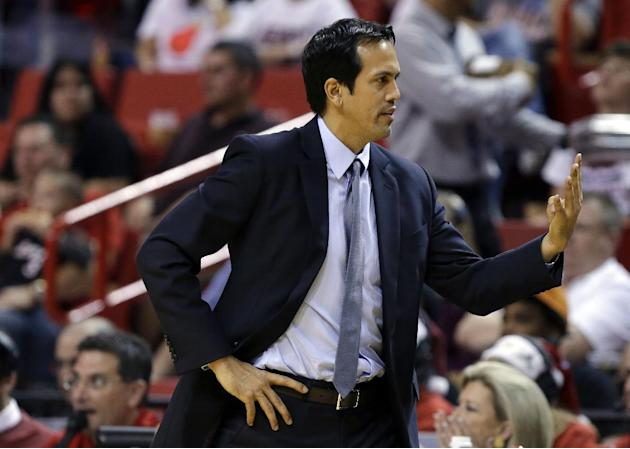 Miami Heat head coach Erik Spoelstra gestures in the second half of an NBA basketball game against the Sacramento Kings, Friday, Dec. 20, 2013, in Miami. The Heat won 122-103