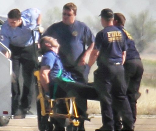 """Emergency workers tend to a JetBlue captain that had a """"medical situation"""" during a Las Vegas-bound flight from JFK International airport, Tuesday, March 27, 2012, in Amarillo, Texas. Passengers said the pilot screamed that Iraq or Afghanistan had planted a bomb on the flight, was locked out of the cockpit, and then tackled and restrained by passengers. The pilot who subsequently took command of the aircraft elected to land in Amarillo at about 10 a.m., JetBlue Airways said in a statement."""