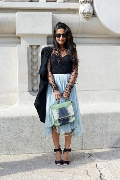 Play with proportions and textures in the same outfit by combining a sheer, swiss dot top with an asymmetrical pale blue calf-length skirt. Tie the look together like this style maven by adding cheeky