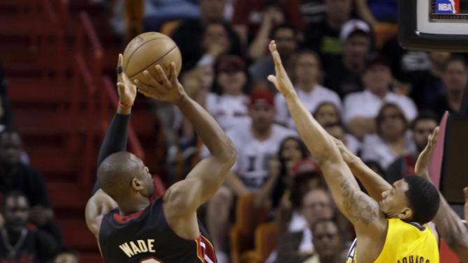 Miami Heat's Dwyane Wade (3) prepares to shoot over Indiana Pacers' Orlando Johnson (11) during the first half of an NBA basketball game in Miami, Sunday, March 10, 2013. (AP Photo/Alan Diaz)