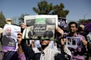 "A supporter of Iranian President Hassan Rouhani, holds a local newspaper with a headline that reads, ""historic call from a return flight,"" upon his arrival from the U.S. near the Mehrabad airport in Tehran, Iran, Saturday, Sept. 28, 2013. Iranians from across the political spectrum hailed Saturday the historic phone conversation between President Barack Obama and Rouhani, reflecting wide support for an initiative that has the backing of both reformists and the country's conservative clerical leadership. (AP Photo/Ebrahim Noroozi)"