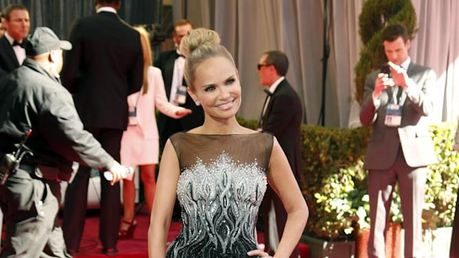 Actress Kristin Chenoweth arrives at the 85th Academy Awards at the Dolby Theatre on Sunday Feb. 24, 2013, in Los Angeles. (Photo by Todd Williamson/Invision/AP)
