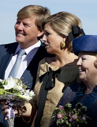 FILE - In this April 30, 2012 file photo, Crown Prince Willem Alexander, his wife Princess Maxima, and Dutch Queen Beatrix, right, listen to singing children during festivities marking Queen&#39;s Day in Rhenen, central Netherlands. Queen Beatrix announced she is to abdicate in favor of Crown Prince Willem Alexander during a nationally televised speech Monday, Jan. 28, 2013. Beatrix, who turns 75 on Thursday, has ruled the nation of 16 million for more than 32 years and would be succeeded by her eldest son, Crown Prince Willem-Alexander. (AP Photo/Peter Dejong, File)