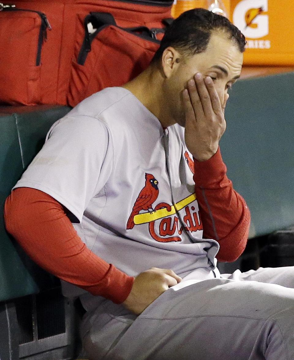 St. Louis Cardinals' Carlos Beltran reacts in the dugout during the ninth inning of Game 6 of baseball's National League championship series against the San Francisco Giants Sunday, Oct. 21, 2012, in San Francisco. (AP Photo/David J. Phillip)