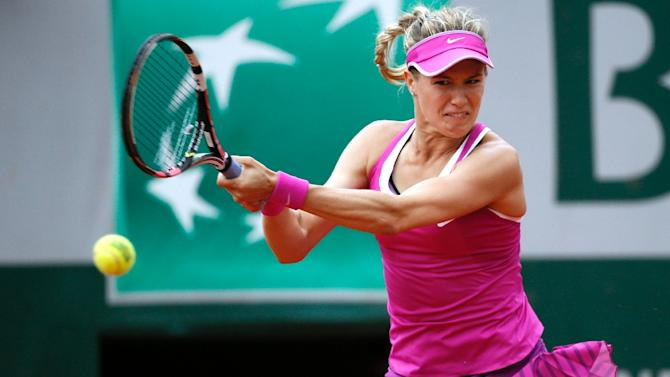 Canada's Eugenie Bouchard returns the ball to France's Kristina Mladenovic during the women's first round of the Roland Garros 2015 French Tennis Open in Paris on May 26, 2015