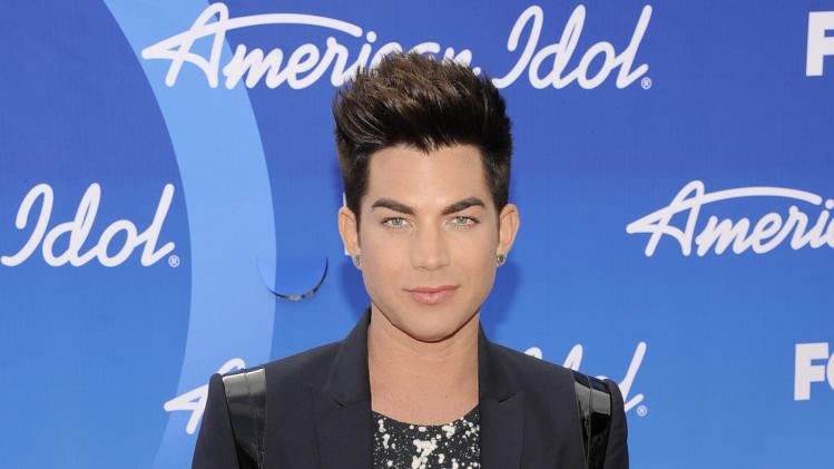 "Adam Lambert arrives at the ""American Idol"" finale at the Nokia Theatre at L.A. Live on Thursday, May 16, 2013, in Los Angeles. (Photo by Chris Pizzello/Invision/AP)"