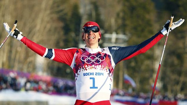 Norway's Ola Vigen Hattestad celebrates as he crosses the finish line to win the men's cross-country sprint free final at the 2014 Sochi Winter Olympics February 11, 2014 (Reuters)