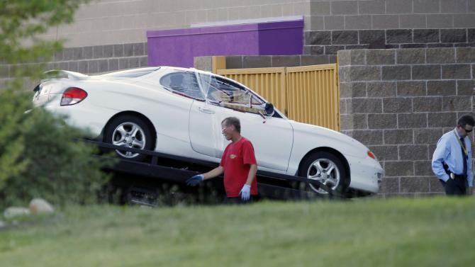"The car of the suspect in the mass shooting at the Century 16 theatre east of the Aurora Mall in Aurora, Colo., is loaded on to a flatbed truck on Friday, July 20, 2012. Authorities report that 12 died and more than three dozen people were shot during an assault at the theatre during a midnight premiere of ""The Dark Knight."" (AP Photo/David Zalubowski)"