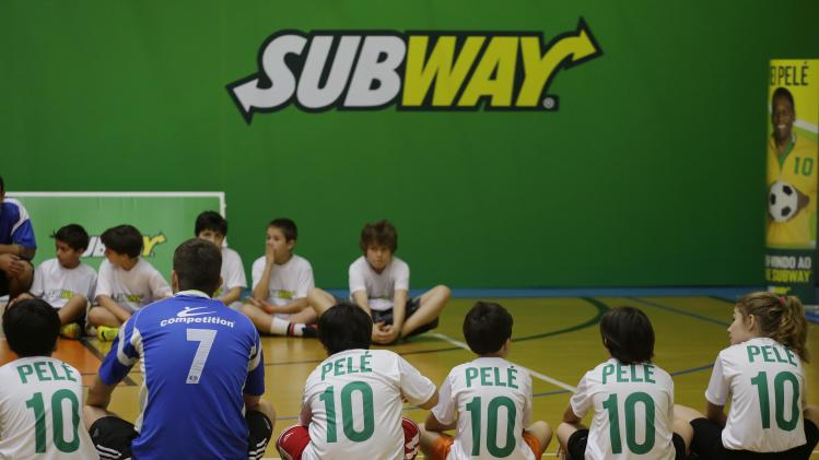 Children wait the arrive of former U.S. Olympic Swimmer Michael Phelps and Brazilian soccer legend Pele at Competition academy, during a event organized by SUBWAY restaurants, on Wednesday, Dec. 4, 2013 in Sao Paulo, Brazil. (Photo by Nelson Antoine/Invision for SUBWAY Restaurants/AP Images)