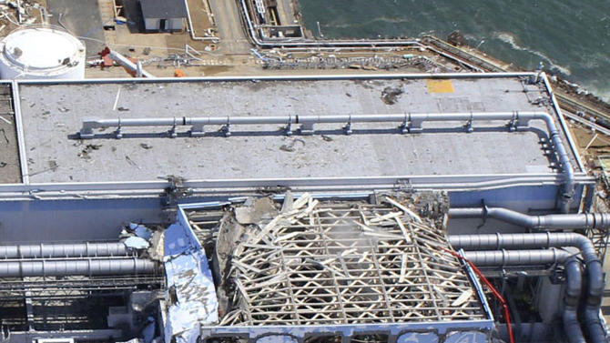 FILE - In this March 24, 2011 file aerial photo taken by a small unmanned drone and released by AIR PHOTO SERVICE, damaged Unit 4 of the crippled Fukushima Dai-ichi nuclear power plant is seen in Okuma, Fukushima prefecture, northeastern Japan. A contentious debate over nuclear power in Japan is also bringing another question out of the shadows: Should Japan keep open the possibility of making nuclear weapons _ even if only as an option? It may seem surprising in the only country ever devastated by atomic bombs, particularly as it marks the 67th anniversary of the bombings of Hiroshima on Aug. 6, 2012, and Nagasaki three days later. The Japanese government officially renounces nuclear weapons, and the vast majority of citizens oppose them. (AP Photo/AIR PHOTO SERVICE, File) MANDATORY CREDIT