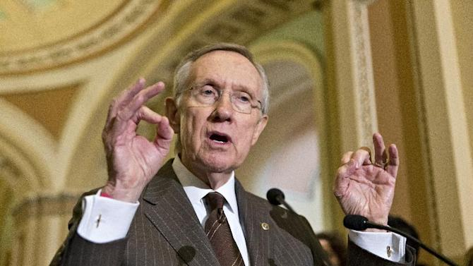 Senate Majority Leader Harry Reid of Nev. gestures as he speaks with reporters on Capitol Hill in Washington, Tuesday, June 4, 2013, following a Democratic strategy session. (AP Photo/J. Scott Applewhite)