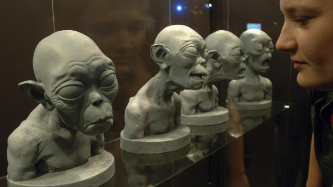"""FILE - In this Jan. 30, 2007 file photo, a visitor looks at original studies of """"Gollum"""" at the exhibition """"The Lord of the Rings"""" at the Movie Park of Potsdam-Babelsberg, Germany, during a press preview tour. The heirs of late author J.R.R. Tolkien are suing the producers of """"The Lord of the Rings"""" and """"The Hobbit"""" movie trilogies over alleged exploitative merchandizing. The lawsuit, filed Monday, Nov. 19, 2012 in U.S. District Court in Los Angeles, comes a week before the premiere of the """"The Hobbit: An Unexpected Journey"""" in Wellington. The opening film in the trilogy hits theaters worldwide next month. (AP Photo/Sven Kaestner, File)"""