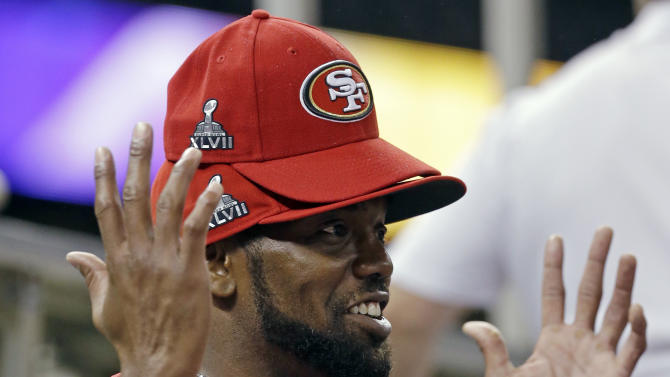 San Francisco 49ers wide receiver Randy Moss wears multiple hats during media day for the NFL Super Bowl XLVII football game Tuesday, Jan. 29, 2013, in New Orleans. (AP Photo/Mark Humphrey)