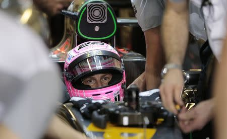 McLaren Formula One driver Jenson Button of Britain sits in his car during the second practice session of the Abu Dhabi F1 Grand Prix at the Yas Marina circuit in Abu Dhabi