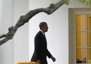 Obama walks to the Oval Office of the White House in Washington