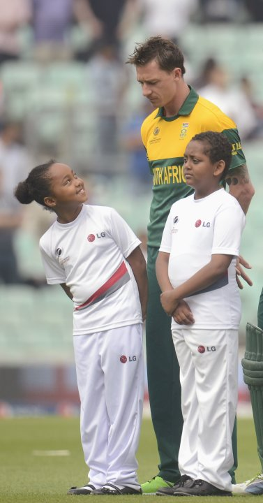 A girl looks up at the injured Dale Steyn before the ICC Champions Trophy semi final match against England in London