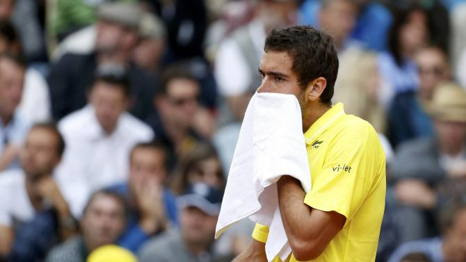 Marin Cilic of Croatia reacts during the men's singles match against Robin Haase of the Netherlands at the French Open tennis tournament at the Roland Garros stadium in Paris