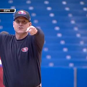 San Francisco 49ers coach Jim Harbaugh sinks half-court shot