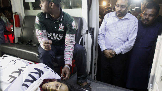 In this Wednesday, March 13, 2013, photo, the body of Pakistani activist Perween Rahman, who was shot by gunmen on Wednesday night lies in an ambulance, in Karachi, Pakistan. A police official says gunmen have shot and killed a pioneering Pakistani activist who worked in some of the poorest neighborhoods of the country's largest city. (AP Photo/Shakil Adil)