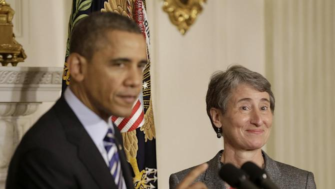 President Barack Obama points towards REI CEO Sally Jewell as he announces that he is nominating her as the next interior secretary replacing outgoing Interior Secretary Ken Salazar, Wednesday, Feb. 6, 2013, in the State Dining Room of the White House in Washington.  (AP Photo/Pablo Martinez Monsivais)