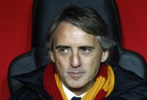 Galatasaray's coach Mancini reacts before the start of his team's Champions League soccer match against Chelsea at Turk Telekom Arena in Istanbul