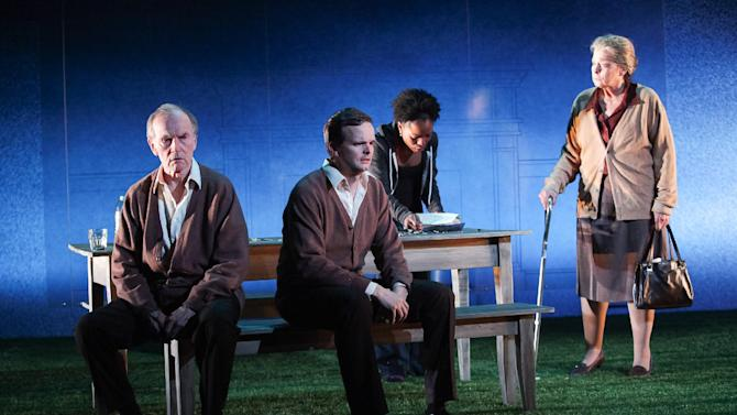 """Shown in a publicity photo released by Lincoln Center Theater are, from left, Robert Hogan, Dashiell Eaves, Marsha Stephanie Blake and Jenny O'Hara, in a scene from the LCT3 production of """"Luck of the Irish,"""" currently performing off-Broadway at the Claire Tow Theater in New York. (AP Photo/Lincoln Center Theater, Erin Baiano.)"""