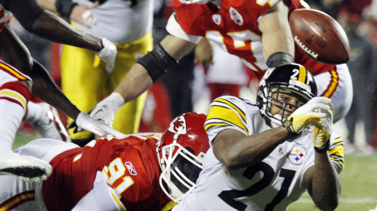 Pittsburgh Steelers running back Mewelde Moore (21) fumbles into the end zone while being tackled by Kansas City Chiefs outside linebacker Tamba Hali (91) during the first half of an NFL football game in Kansas City, Mo., Sunday, Nov. 27, 2011. (AP Photo/Ed Zurga)