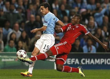 Manchester City's Navas challenged by Bayern Munich's Alaba during Champions League soccer match in Manchester