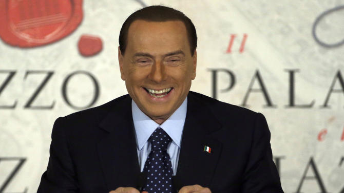 """FILE - A Wednesday, Dec. 12, 2012 photo from files showing People of Freedom party leader Silvio Berlusconi smiling as he speaks during a book presentation of Italian journalist Bruno Vespa """"Il Palazzo e la Piazza"""" (The Palace and the Square) in Rome. Former Italian premier Silvio Berlusconi has revealed he is engaged to a woman almost 50 years his junior, and says that """"finally I feel less alone.""""The 76-year-old media baron said Sunday his engagement to 28-year-old Francesca Pascale — part of a support group called """"Silvio, we miss you"""" — is """"official"""". (AP Photo/Gregorio Borgia, File)"""