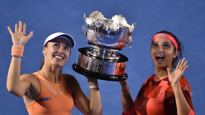 Switzerland's Martina Hingis (L) and India's Sania Mirza, seen in Melbourne on January 29, 2016, are now close to setting the longest winning streak since 1990, when Jana Novotna and Helena Sukova won 44 in a row