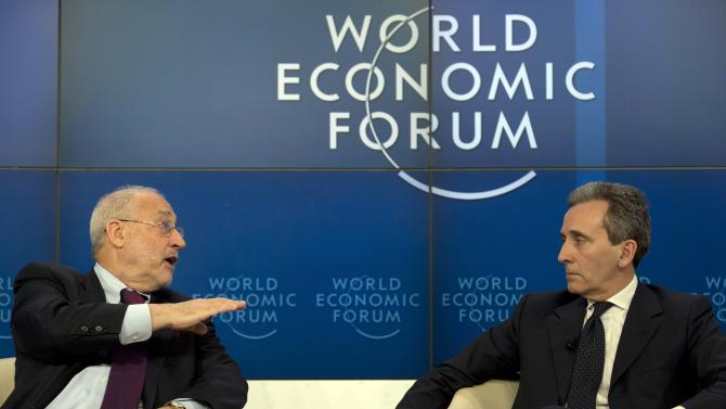 U.S. professor Joseph E. Stiglitz, left, talks to Vittorio Grilli, Italian Minister for Economy and Finance in the Associated Press session 'Creating Economic Dynamism' during the 43rd Annual Meeting of the World Economic Forum, WEF, in Davos, Switzerland, Friday, Jan. 25, 2013.  (AP Photo/Anja Niedringhaus)