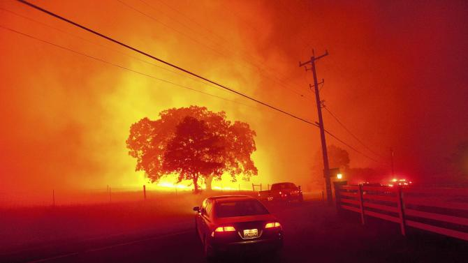 Residents flee as winds whip flames from the Morgan fire along Morgan Territory Road near Clayton, California