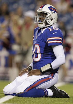 Buffalo Bills' Vince Young kneels on the turf after throwing an interception against the Pittsburgh Steelers during the second half of a preseason NFL football game in Orchard Park, N.Y., Saturday, Aug. 25, 2012. The Steelers won 38-7. (AP Photo/Gary Wiepert)