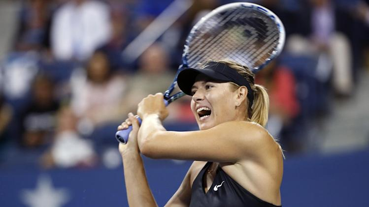 Maria Sharapova, of Russia, returns a shot to Sabine Lisicki, of Germany, during the third round of the U.S. Open tennis tournament Friday, Aug. 29, 2014, in New York. (AP Photo/Jason DeCrow)