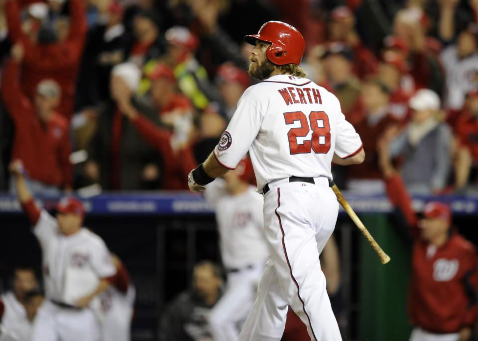 Washington Nationals' Jayson Werth watches his game-winning solo home run in the ninth inning of Game 4 of the National League division baseball series against the St. Louis Cardinals on Thursday, Oct. 11, 2012, in Washington. Washington won 2-1. (AP Photo/Nick Wass)