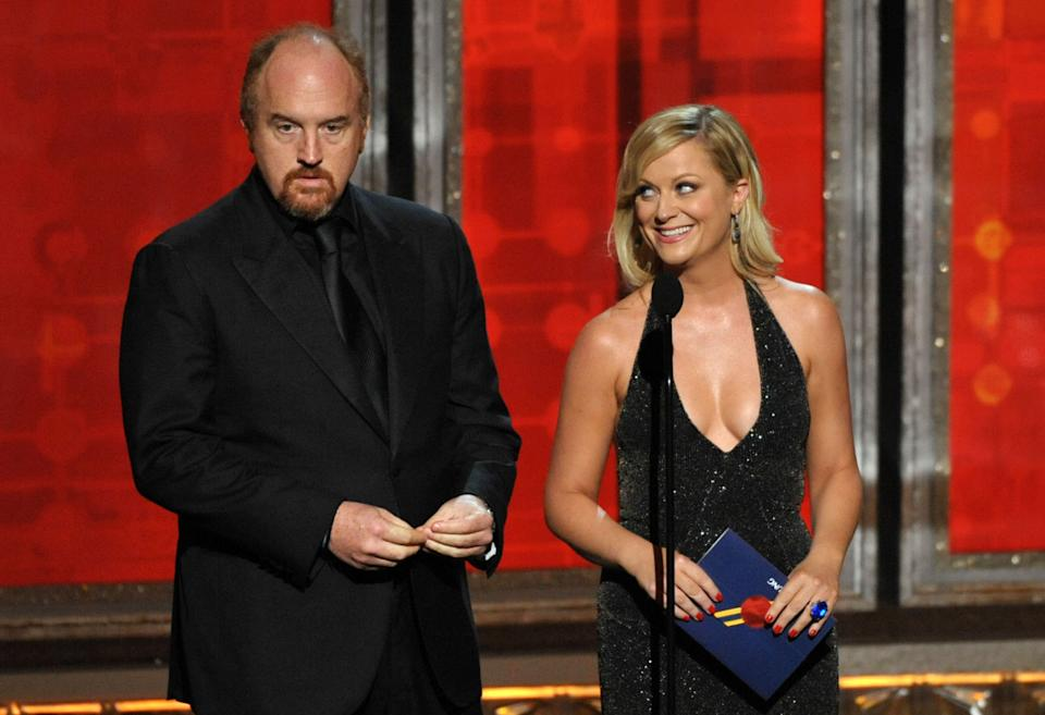Louis C.K., left, and Amy Poehler present an award onstage at the 64th Primetime Emmy Awards at the Nokia Theatre on Sunday, Sept. 23, 2012, in Los Angeles. (Photo by John Shearer/Invision/AP)