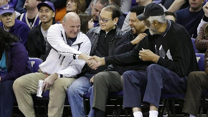 "FILE - In this Jan. 25, 2014, photo, then-Microsoft CEO Steve Ballmer, left, shakes hands with former NBA players Bill Russell, right, and ""Downtown"" Freddie Brown as Omar Lee looks on during an NCAA college basketball game between Washington and Oregon State in Seattle. An individual with knowledge of negotiations to sell the Los Angeles Clippers said Shelly Sterling has reached an agreement to sell the team to Ballmer for $2 billion. The individual, who wasn't authorized to speak publicly, told The Associated Press on Thursday, May 29, 2014, that Ballmer and the Sterling Family Trust now have a binding agreement. The deal now must be presented to the NBA. (AP Photo/Elaine Thompson, File)"