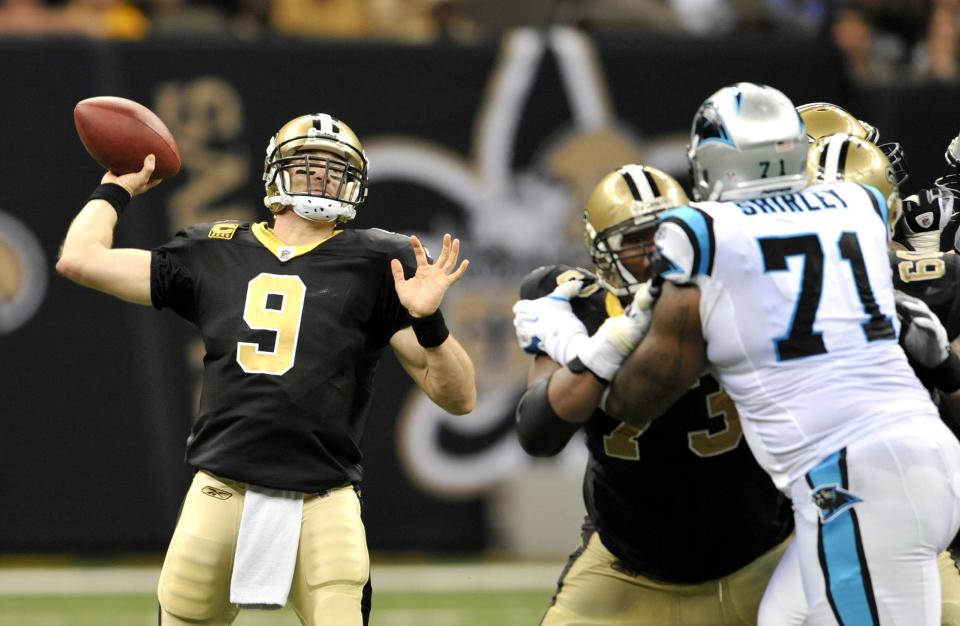 New Orleans Saints quarterback Drew Brees (9) passes as Carolina Panthers defensive tackle Jason Shirley (71) rushes during the second quarter of an NFL football game in New Orleans, Sunday, Jan. 1, 2012. (AP Photo/Bill Feig)